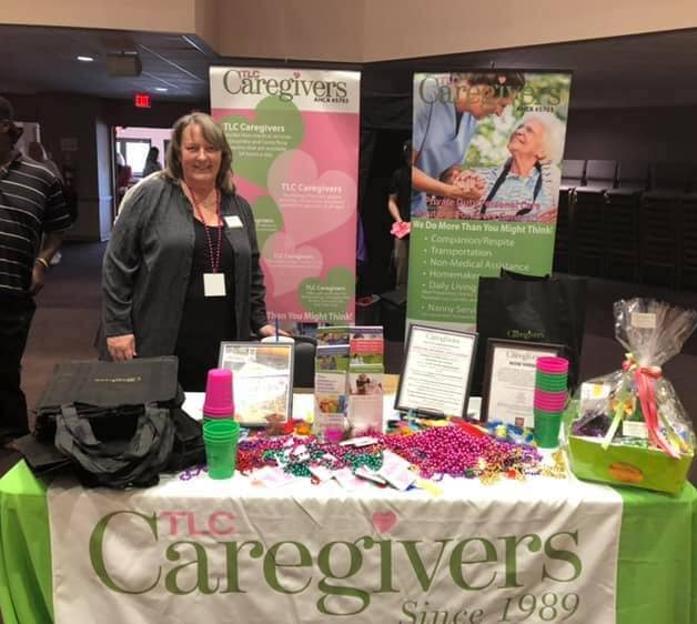 Photo of a member of the TLC Caregivers staff at a convention